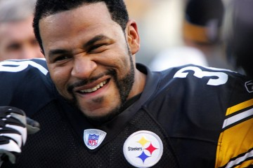 Pittsburgh Steelers running back Jerome  Bettis reacts to scoring his third touchdown of the game against the  Detroit Lions during NFL football action Sunday, Jan 1, 2006 at Pittsburgh. Bettis led the Steelers to a 35-21 win over the Lions and into the playoffs.(AP Photo/Gene J. Puskar)