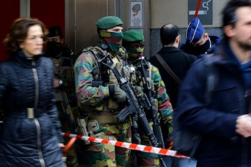 Brussels Airport explosions. Armed officers stand guard outside de Brouckere Metro station in Brussels, following yesterdays terrorist attacks in the city. Picture date: Wednesday March 23, 2016. Belgium entered its second day of mourning over the terror attacks that shook Europe in which 34 people are known to have died and at least 198 - including two Britons - were injured. See PA story POLICE Brussels. Photo credit should read: Gareth Fuller/PA Wire URN:25901305