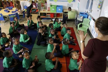 Kindergarten teacher Alexa Wolfe teaches her students at KIPP Thrive Academy, a new school in what had been the closed Eighteenth Avenue School, Wednesday, Sept. 9, 2015, in Newark, N.J.When Facebook founder Mark Zuckerberg appeared on Oprah Winfreyís show five years ago with a Democratic mayor and Republican governor to announce a $100 million donation to try to remake the education system in Newark, it was presented as an effort to make a struggling city into a national model for turning around urban schools systems. Thanks to Zuckerbergís money and another $100 million in matching donations, thousands of children have switched to publicly funded charter schools, where educational outcomes have generally been better for students. But the sped-up exodus has left traditional public schools in an ever-worsening financial condition and thereís been no marked improvement in performance for the students left there; by several measures, there have been declines. (AP Photo/Mel Evans)
