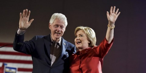 Democratic U.S. presidential candidate Hillary Clinton and her husband former President Bill Clinton wave to supporters after she was projected to be the winner in the Democratic caucuses  in Las Vegas, Nevada February 20, 2016. REUTERS/David Becker      TPX IMAGES OF THE DAY