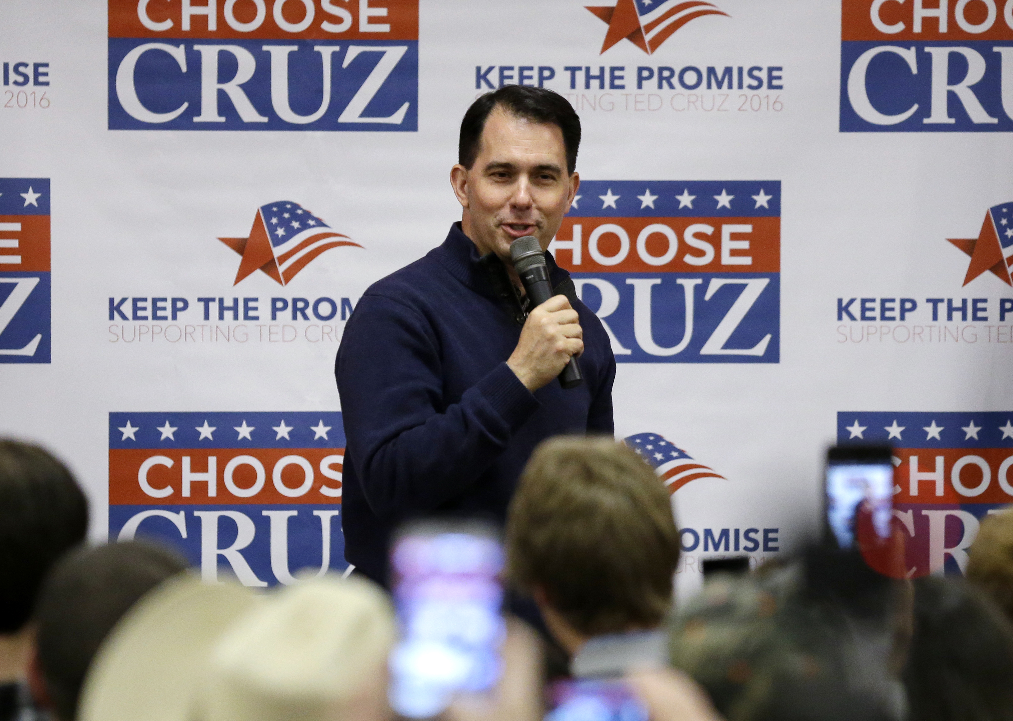Gov. Scott Walker introduces Republican presidential candidate Sen. Ted Cruz, R-Texas, during a campaign event at the Florian Gardens, Sunday, April 3, 2016, in Eau Claire, Wis. (AP Photo/Nam Y. Huh)