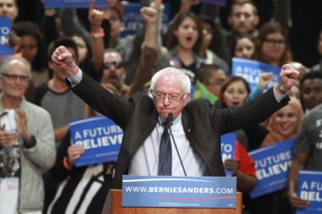 March 22, 2016 - San Diego, USA - SAN DIEGO, March 22, 2016 | Democratic presidential candidate Bernie Sanders holds up his fists as he speaks to a crowd of supporters during a campaign rally at the San Diego Convention Center in San Diego on Tuesday. | -Mandatory Photo Credit: Photo by Hayne Palmour IV/San Diego Union-Tribune, LLC (Credit Image: © Hayne Palmour Iv/U-T San Diego via ZUMA Wire)