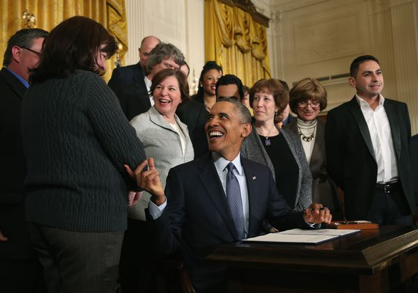 Obama signing the new regulations in 2014.