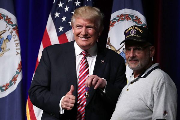 Trump with veteran Louis Dorfman on Tuesday.