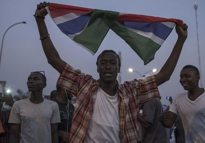 People celebrating in the streets of Gambia
